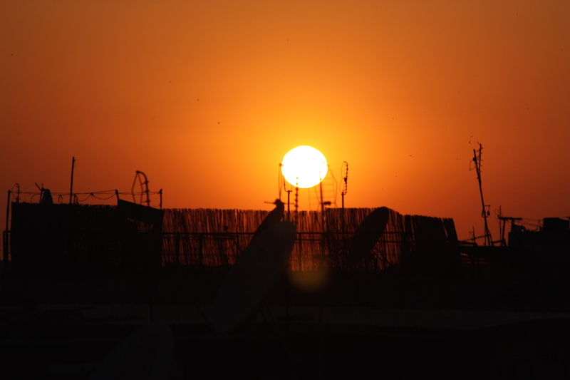 Watching the sun set over satellite dishes from our riad's rooftop