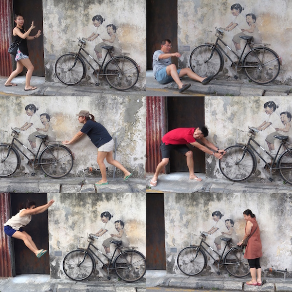 Coming up with creative poses with probably the most famous wall mural of them all - Little Children on a Bicycle