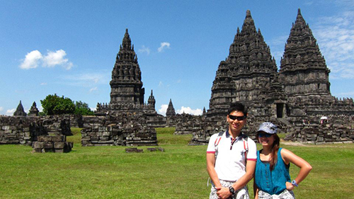 It's us and the ancient hindu temples on the green grass against the blue skies
