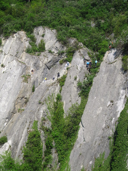 Climbers on the natural rock walls of Grenoble